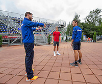 Moscow, Russia, 14 th July, 2016, Tennis,  Davis Cup Russia-Netherlands, Dutch team practise, Wesley Koolhof (R) and Tim van Rijthoven  warming up with fysio Edwin Visser (L)<br /> Photo: Henk Koster/tennisimages.com