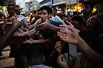 BAGHDAD, Iraq: 14th June 2014<br /> <br /> Men prepare to break their fast in Baghdad's Shiite suburb of Kadhimiya. <br /> <br /> <br /> Fixer: Haider Kata +9647704425647<br /> <br /> Ayman Oghanna for National Geographic