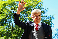 Arsenal manager Arsene Wenger waves at fans as he steps off the team coach before his final game in charge of Arsenal during the Premier League match between Huddersfield Town and Arsenal at the John Smith's Stadium, Huddersfield, England on 13 May 2018. Photo by Thomas Gadd / PRiME Media Images.