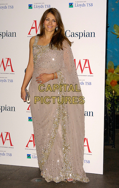 ELIZABETH HURLEY.Asian Women of Achievement Awards, London Hilton, London, England..May 23rd, 2007.full length Liz beige wrap sari style dress jewel encrusted  silver clutch purse.CAP/CAN.©Can Nguyen/Capital Pictures