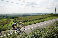 5 man breakaway group with Aleksejs Saramotins (LAT/IAM) &amp; Thomas Wertz (BEL/Color Code - Biowanze) passes (belgian!) wine fields on the south slope of the Kemmelberg<br /> <br /> stage 2<br /> Euro Metropole Tour 2014 (former Franco-Belge)