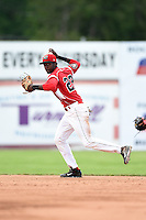 Batavia Muckdogs shortstop Javier Lopez (22) throws to first after making a stop up the middle during a game against the Williamsport Crosscutters on July 27, 2014 at Dwyer Stadium in Batavia, New York.  Batavia defeated Williamsport 6-5.  (Mike Janes/Four Seam Images)