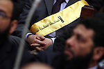 """A member of the Egyptian parliament wears a banner reading """"No to military trials"""" as parliament members attend the first Egyptian parliament session after the revolution that ousted former President Hosni Mubarak, in Cairo January 23, 2012. Egypt's parliament began its first session on Monday since an election put Islamists in charge of the assembly following the overthrow of Mubarak in February. Photo by Ahmed Asad"""