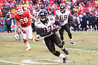 Jacksonville Jaguars tight end George Wrighster runs with the ball during the second half at Arrowhead Stadium in Kansas City, Missouri on December 31, 2006. The Chiefs won 35-30.