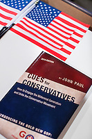 """A copy of John Paul Moran's book """"Cues for Conservatives: How to engage the millennial generation and unite the conservative movement"""" lays on a desk in his live/work studio in Boston, Massachusetts. Moran is a Trump supporter who will be traveling to Washington DC to attend the inauguration and associated events as Donald Trump is sworn in as president of the United States. Moran volunteered with the Trump campaign in Massachusetts and helped organize rallies around his """"#HerLiesMatter"""" campaign."""