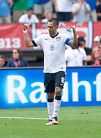 Clint Dempsey (8) of the USMNT celebrates his goal during the game at RFK Stadium in Washington DC.  The USMNT defeated Germany, 4-3, in a friendly match.