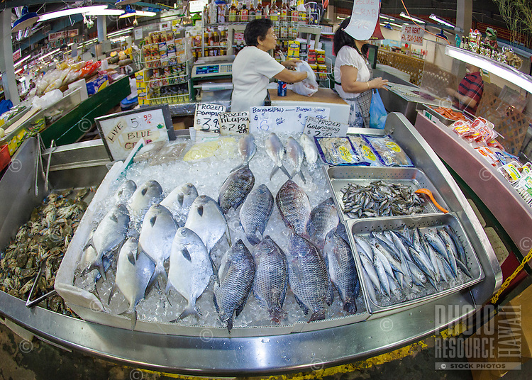 Display of fish and crab for sale at a seafood market in Chinatown, Honolulu, O'ahu