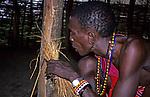 Africa, Kenya. Maasai tribesman demonstrates starting fire