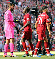 Liverpool's Alisson Becker (left) and Sadio Mane console each other as they are left dejected at the final whistle<br /> <br /> Photographer Rich Linley/CameraSport<br /> <br /> The Premier League - Liverpool v Wolverhampton Wanderers - Sunday 12th May 2019 - Anfield - Liverpool<br /> <br /> World Copyright © 2019 CameraSport. All rights reserved. 43 Linden Ave. Countesthorpe. Leicester. England. LE8 5PG - Tel: +44 (0) 116 277 4147 - admin@camerasport.com - www.camerasport.com