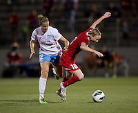 Conny Pohlers (16) of the Washington Spirit is fouled by Leslie Osborne (12) of the Chicago Red Stars during the game at the Maryland SoccerPlex in Boyds, Md.   Chicago defeated Washington, 2-0.