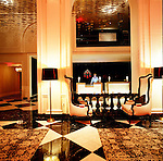 The lobby of the W Hotel in Washington D.C. , adjacent to the Treasury Building, features some of the original architecture of the old Washington Hotel.
