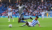Lincoln City's John Akinde is fouled by Huddersfield Town's Herbert Bockhorn<br /> <br /> Photographer Chris Vaughan/CameraSport<br /> <br /> The Carabao Cup First Round - Huddersfield Town v Lincoln City - Tuesday 13th August 2019 - John Smith's Stadium - Huddersfield<br />  <br /> World Copyright © 2019 CameraSport. All rights reserved. 43 Linden Ave. Countesthorpe. Leicester. England. LE8 5PG - Tel: +44 (0) 116 277 4147 - admin@camerasport.com - www.camerasport.com