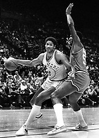 Warriors Joe Barry Carroll guarded by 76er Darryl Dawkins.<br />