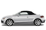 Drive side profile view of a 2007 - 2010 Audi TT Roadster with top up