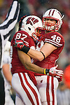 Wisconsin Badgers tight end Jacob Pedersen (48) celebrates wide receiver Nick Toon (87) touchdown reception during an NCAA Big Ten Conference college football game against the Penn State Nittany Lions on November 26, 2011 in Madison, Wisconsin. The Badgers won 45-7. (Photo by David Stluka)