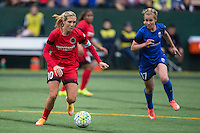 Seattle, Washington - Saturday May 14, 2016: Portland Thorns FC midfielder Allie Long (10) is marked by Seattle Reign FC midfielder Beverly Yanez (17) during the first half of a match at Memorial Stadium on Saturday May 14, 2016 in Seattle, Washington. The match ended in a 1-1 draw.