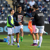 (L-R) Kyle Naughton and Jack Cork of Swansea City wearing Show Racism Red Card before the Premier League match between Swansea City and Watford at The Liberty Stadium on October 22, 2016 in Swansea, Wales, UK.