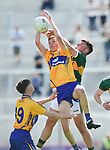 Emmet McMahon of Clare in action against Darragh Rahilly of Kerry during their Munster Minor football final at Pairc Ui Chaoimh. Photograph by John Kelly.