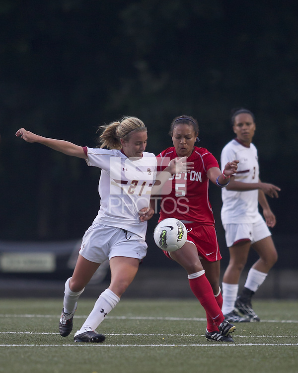 Boston College forward/midfielder Kate McCarthy (21) and Boston University forward/midfielder Tiya Gallegos (5) battle for loose ball. After 2 complete overtime periods, Boston College tied Boston University, 1-1, after 2 overtime periods at Newton Soccer Field, August 19, 2011.