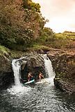 USA, Hawaii, The Big Island, Hilo, paddle boarding on the Wailuku River near the Singing Bridge