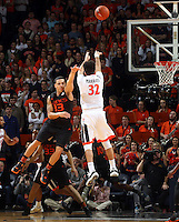 Virginia guard London Perrantes (32) and Miami guard Angel Rodriguez (13) during the game Tuesday, Jan. 12, 2016 in Charlottesville, Va. Virginia defeated Miami 66-58. Photo/Andrew Shurtleff