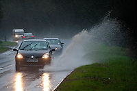 Friday 31 January 2014<br /> Pictured: A car drives along the waterlogged A477 near Llanddowror, west Wales<br /> Re: Severe weather warnings are issued accross Wales and England