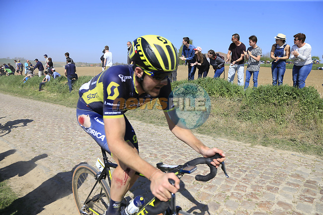 The peloton including Luke Durbridge (AUS) Orica-Scott on pave sector 25 Briastre a Solesmes during the 115th edition of the Paris-Roubaix 2017 race running 257km Compiegne to Roubaix, France. 9th April 2017.<br /> Picture: Eoin Clarke | Cyclefile<br /> <br /> <br /> All photos usage must carry mandatory copyright credit (&copy; Cyclefile | Eoin Clarke)