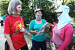 "Veterans for Peace member Joni Clemens talks with two women in the village of A Luoi, Vietnam. The women are beneficiaries of the ""Orange Cow"" program, sponsored by the Australia-based Vietnamese Victims of Agent Orange Trust,  which raises money to purchase breeding cows for families who have been affected by Agent Orange exposure. Veterans for Peace toured Vietnam in April to learn about efforts to mitigate the suffering of the country's Agent Orange victims and people who have been injured by bombs and land mines left over from the war. April 25, 2013."