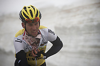 Maarten Tjallingii (NLD/LottoNL-Jumbo) getting a 'gazetta' underneath his jersey up the snow-covered Colle dell'Agnello (2744m) to protect him against the cold on the way down. <br /> <br /> stage 19: Pinerolo(IT) - Risoul(FR) 162km<br /> 99th Giro d'Italia 2016