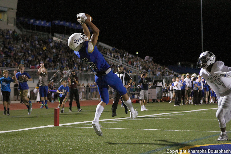 Boswell's Jonel Reed makes a touchdown reception in the fourth quarter to put Boswell up 28-21 in the fourth quarter against Burleson Centennial in high school football in Fort Worth on Friday, September 11, 2015. (photo by Khampha Bouaphanh)