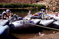 Tourists in rubber raft on the Colorado River at Lees Ferry in Grand Canyon, Arizona, USA