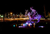 "The Captain Jack Statue ""The Spirit of Mecklenburg"" glows at night. The statue was created by The May 20th Society, an organization dedicated to the 1775 signing of the Mecklenburg Declaration of Independence. Artist Chas Fagan created the statue, which is located on the Little Sugar Creek Greenway at the corner of 4th Street and Kings Drive."