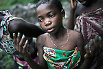 KINSHASA, DEMOCRATIC REPUBLIC OF CONGO - APRIL 30: Esther Yandakwa, age 9, looks at her freshly painted nails on April 30, 2006 in Matonge district in central Kinshasa, Congo, DRC. Esther is homeless and works a prostitute together with four fourteen-year-old friends. They live outside next to a polluted river. She's been three years on the street and has run away from her family. She has from time to time been living in a homeless shelter but doesn't like the rules there. She usually smokes cigarettes, marijuana, drinks whiskey and sometimes takes Valium. She charges the clients as little as US$ 1. About 15,000 children are estimated to live on the streets of Kinshasa. Congo, DRC is in ruins after forty years of mismanagement by the corrupt dictator and former president Mobuto Sese Seko. He fled the country in 1997 and a civil war started. The country is planning to hold general elections by July 2006, the first democratic elections in forty years.(Photo by Per-Anders Pettersson)