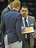 Tom Pecora, Associate Head Coach for Quinnipiac University Men's Basketball, right, talks with fellow members of the coaching staff during an MAAC game against Fairfield University at Nassau Coliseum on Saturday, Jan. 27, 2018.