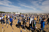 Earthquakes fans walk on the field for Groundbreaking Ceremony at new stadium in Santa Clara, California on October 21st, 2012.  San Jose Earthquakes broke Guinness World Record for 6,256 people break ground on Quakes' new stadium.