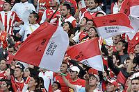 BOGOTÁ -COLOMBIA, 13-09-2014. Hinchas de Santa Fe muestran apoyo a su equipo durante el encuentro entre Independiente Santa Fe y Millonarios por la fecha 9 de la Liga Postobón II 2014 jugado en el estadio Nemesio Camacho El Campín de la ciudad de Bogotá./ Fans of Santa Fe show their support to their team during the match between Independiente Santa Fe and Millonarios for the 9th date of the Postobon League I 2014 played at Nemesio Camacho El Campin stadium in Bogotá city. Photo: VizzorImage/ Gabriel Aponte / Staff