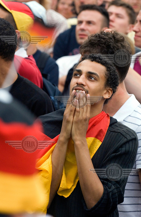 A German fan of North African descent at a public screening on the 'Fan Mile' of Germany's quarter final match in the 2006 football World Cup.