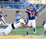 BROOKINGS, SD - SEPTEMBER 24:  Brady Mengarelli #44 from South Dakota State University tries to slip the grasp of Brett Taylor #44 from Western Illinois in the first half of their game Saturday evening at Dana J. Dykhouse Stadium in Brookings. (Photo by Dave Eggen/Inertia)