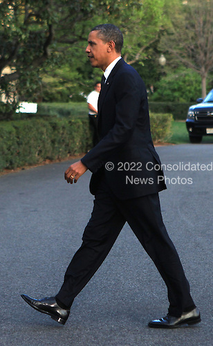 United States President Barack Obama walks from Marine One to the White House in Washington, D.C. on March 22, 2012 after his returns from Ohio..Credit: Dennis Brack / Pool via CNP