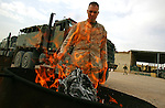 A few days before they begin the journey back to the United States after eight months in Najaf, Iraq, a Marine with Charlie Co. 1st Battalion 4th Marines burns secret documents and maps before the trip to Kuwait on January 31, 2005.