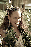 Lovely young local bride smiling at her wedding at Ke'iki Beach, North Shore
