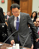 Washington, D.C. - February 24, 2010 --  Akio Toyoda, President and CEO, Toyota Motor Corporation takes his seat as he prepares to testify before the U.S. House Committee on Government and Reform examining the Federal government's response to the recall of millions of Toyota vehicles due to reports of malfunctioning gas pedals, and to gain a better understanding of the nature of the sudden acceleration problem in Toyota vehicles and what should be done about it..Credit: Ron Sachs / CNP.(RESTRICTION: NO New York or New Jersey Newspapers or newspapers within a 75 mile radius of New York City)