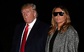 United States President Donald J. Trump looks to the press as he and first lady Melania Trump return to the White House, Tuesday, November 12, 2019, in Washington, DC. Trump spent a long Veteran's Day weekend in New York City.  <br /> Credit: Mike Theiler / Pool via CNP