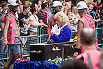 © Joel Goodman - 07973 332324 . 24 August 2013 . Manchester , UK . Margaret Thatcher raising out from her coffin , carried by miners . 2013 Gay Pride Parade through Manchester City Centre . This year's theme is 1980s . Photo credit : Joel Goodman