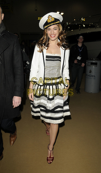 KELLY BROOK.The London International Boat Show press & preview day, ExCel Centre, Docklands, London, England..January 9th, 2009.full length black white dress nautical sailor hat jacket striped stripes red t-bar shoes .CAP/CAN.©Can Nguyen/Capital Pictures.