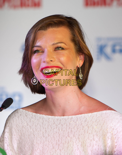 """Milla Jovovich.Press conference of a film """"Lucky Trouble"""", Moscow, Russia..February 13th, 2011.headshot portrait white red lipstick dangling silver earrings sequins smiling sequined .CAP/PER/SB.©SB/PersonaStars/CapitalPictures"""
