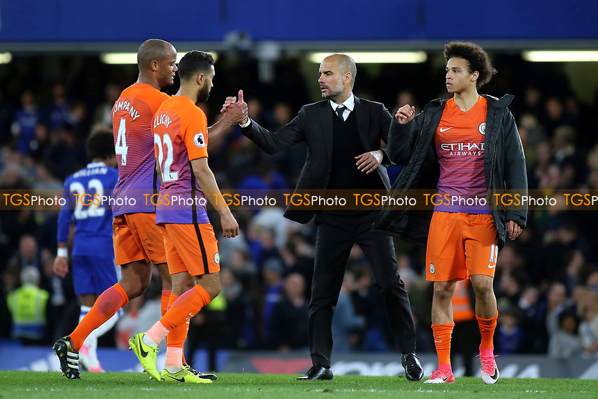 Manchester City Manager, Pep Guardiola, shakes hands with Vincent Kompany at the final whistle during Chelsea vs Manchester City, Premier League Football at Stamford Bridge on 5th April 2017