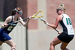 Los Angeles, CA 04/18/10 - Jessica Dresser (UC Davis # 21) and Amanda Nespor (Cal Poly #15) in action during the 2010 Western Women Lacrosse League Championship game between UC Davis and Cal Poly SLO for third place, hosted by UCLA.  UC Davis edged Cal Poly SLO 8-7 in overtime.