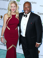 CULVER CITY, LOS ANGELES, CA, USA - NOVEMBER 08: Jennifer Lucas, Byron Allen arrive at the 3rd Annual Baby2Baby Gala held at The Book Bindery on November 8, 2014 in Culver City, Los Angeles, California, United States. (Photo by Xavier Collin/Celebrity Monitor)
