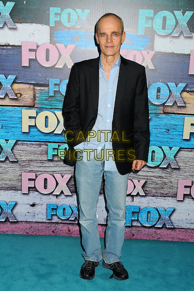 Zeljko Ivanek.Fox All-Star Party - Summer 2012 held at Private Location, West Hollywood, California, USA..July 23rd, 2012.full length jacket jeans denim hand in pocket black blue shirt glasses .CAP/ADM/BP.©Byron Purvis/AdMedia/Capital Pictures.